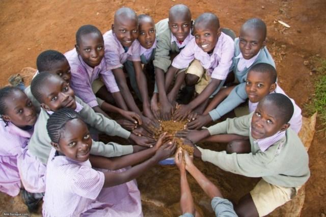 School children helping make water filters, Kitale, Rift Valley province, Kenya.