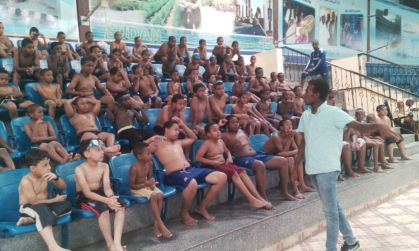 Boys learning about water safety before swimming lessons