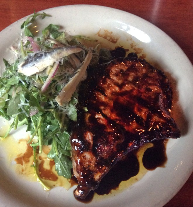 Pork Chop with arugula, white anchovies, parmigiano-reggiano, balsamic vinegar