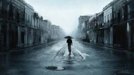 uomo-ombrello-pioggia