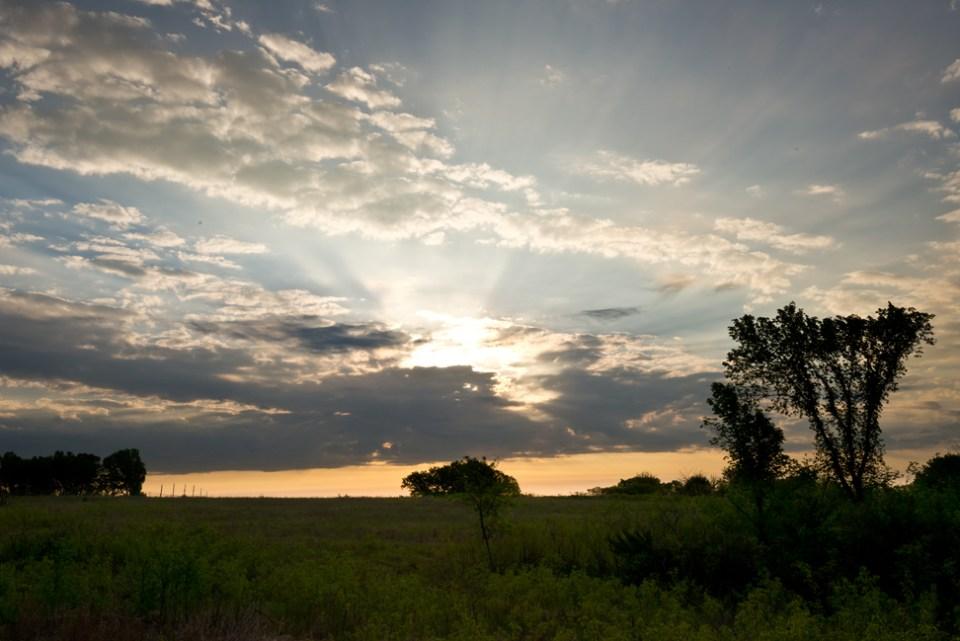 Peach Dawn Behind Gray Clouds