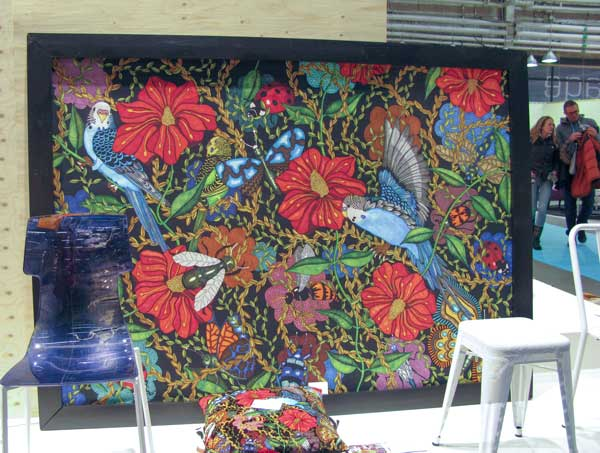 Big, colorful painting on cloth.