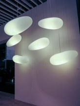 Ceiling lamps floating above. Interesting shapes.