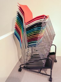 Chairs in a pile