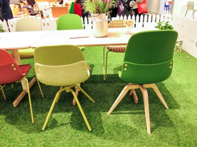 "Colorful chairs with ""buttons"" as decoration at their backs"