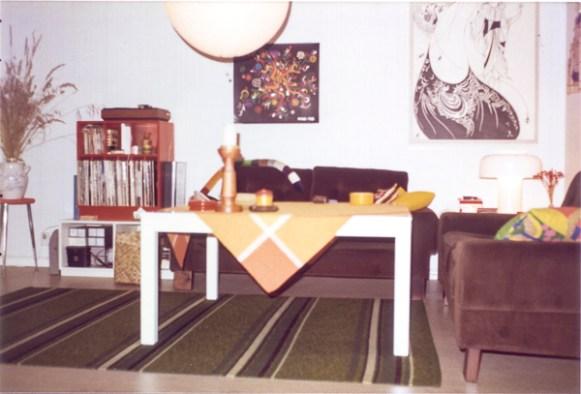 White sofa-table. Green carpet-