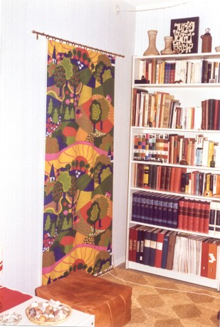 Where did that colorful cloth on the wall go? Have no idea.