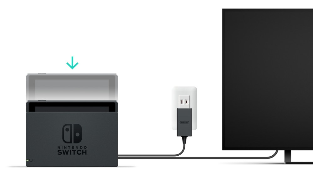 medium resolution of a nintendo switch console being inserted a nintendo switch dock that is plugged into a wall
