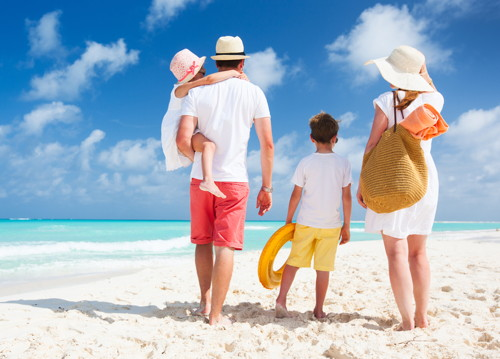 Sun Safety family on beach photo