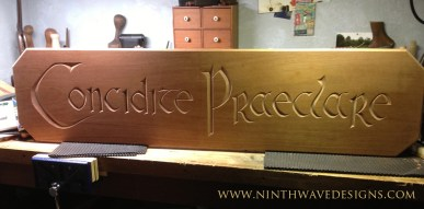 Hand carved sign in mahogany.