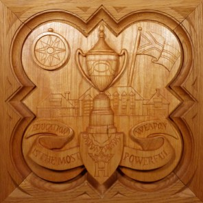 """SPS Form of 1994 Plaque, 11.25"""" x 11.25"""", stained basswood."""