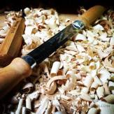 Shavings from the drawknife, used to shape the outside edges of the carving.