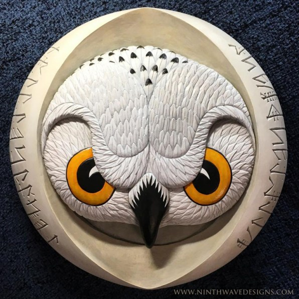 """Old Woman of the Night: Hand carved basswood with painted finish 11.75"""" diameter x 2"""" thick."""