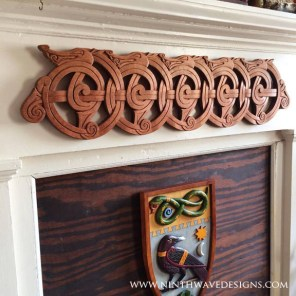 The Dragestil carving hanging on the mantel.