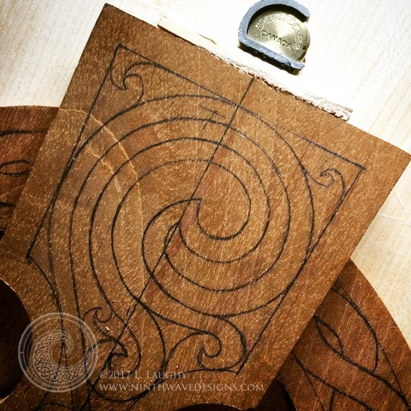 The design is drawn on the wood for the water element arm section.