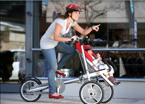 a bike with a child seat at the front that converts into a stroller when necessary