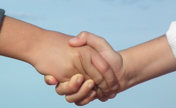 Social and emotional intelligenge illustrated by an image of children shaking hands
