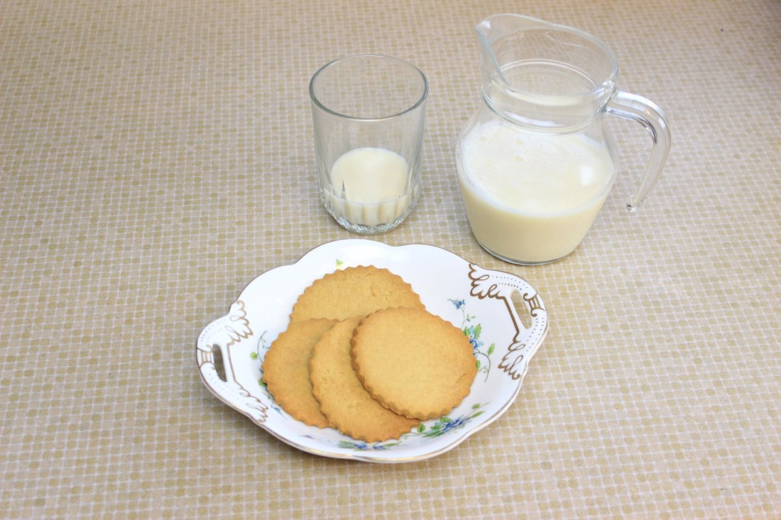 Image of homemade baa biscuits with a glass and jug of milk