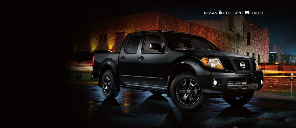 medium resolution of 2019 nissan frontier midnight edition in magnetic black parked in city