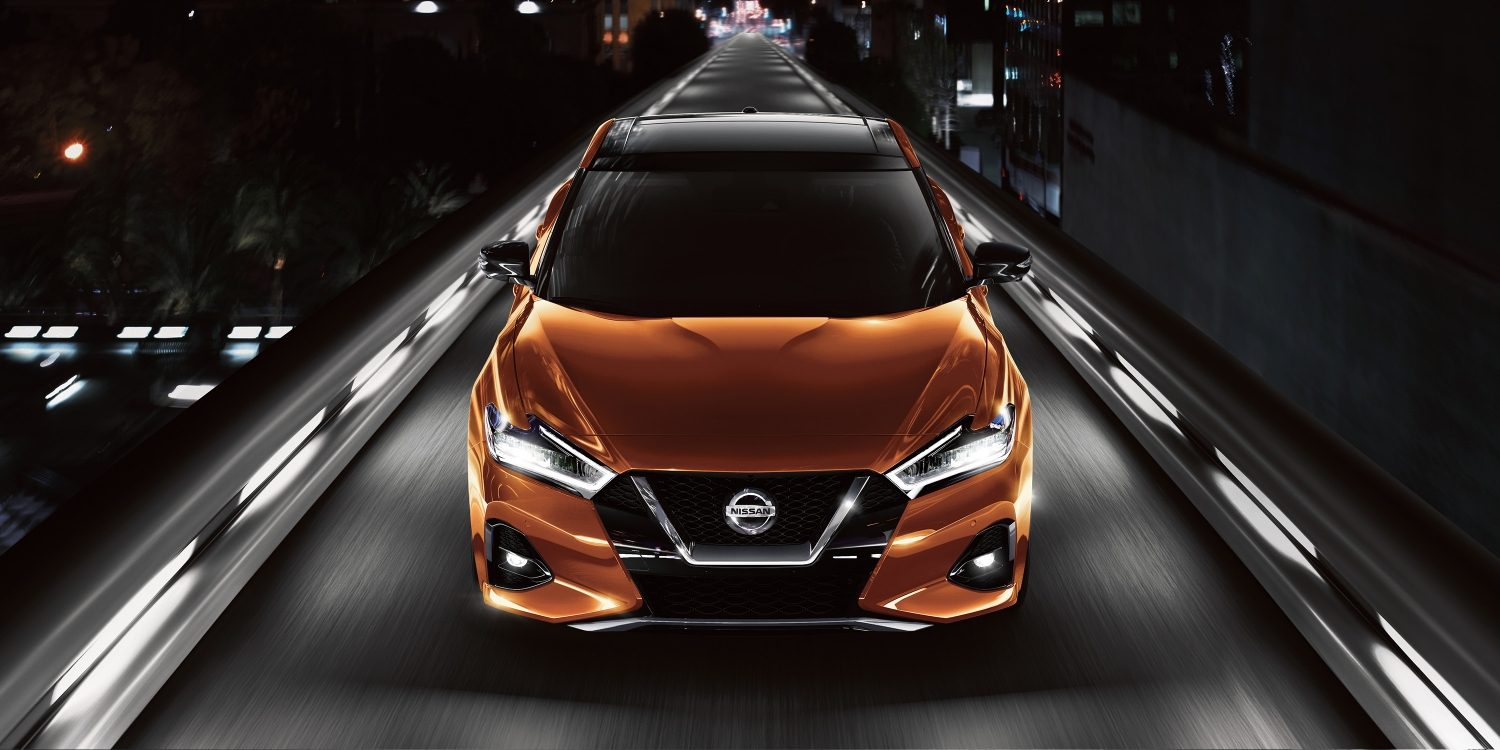 hight resolution of 2019 nissan maxima in sunset drift chromaflair leaving city at night