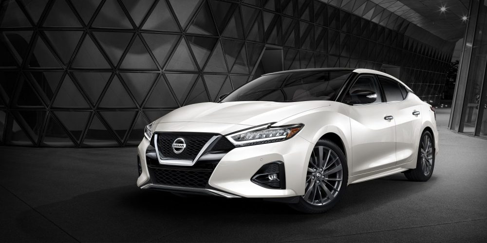 medium resolution of 2019 nissan maxima pearl white tricoat in front of city skyline at night