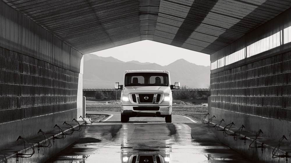 medium resolution of nissan nv passenger pulling into testing building