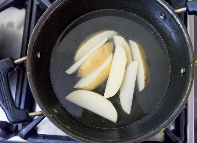 Now par-boil the potato adding little salt..