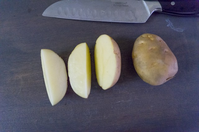 Cut half of the potato in quarter half