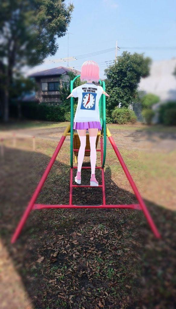 Maple @maplewalnut63 climbing up a slide wearing itopoid VIRTUAL REALI-T vol2 T-shirt