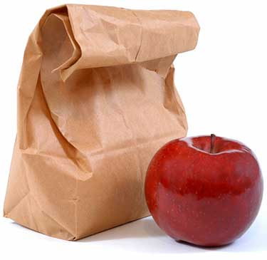 Photo of a brown bag lunch and an apple