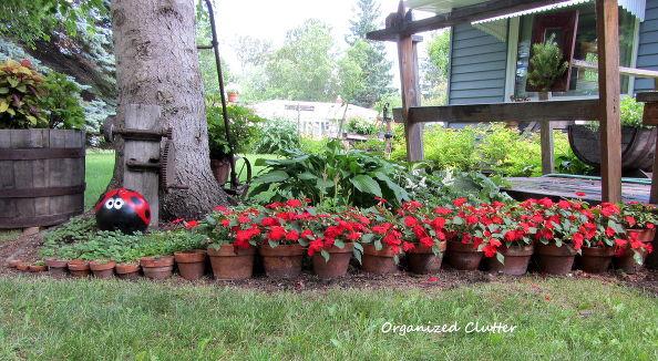 Terra Cotta Pots and Flowers Edging via Carlene @Organized Clutter