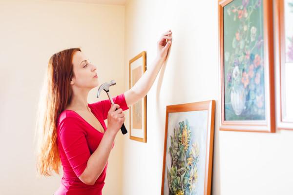 Hammering Art Into Wall