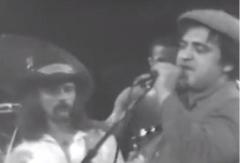 John Belushi sings as Dickey Betts of the Allman Brothers Band plays guitar at the Capitol Theatre in Passaic in April 1979.