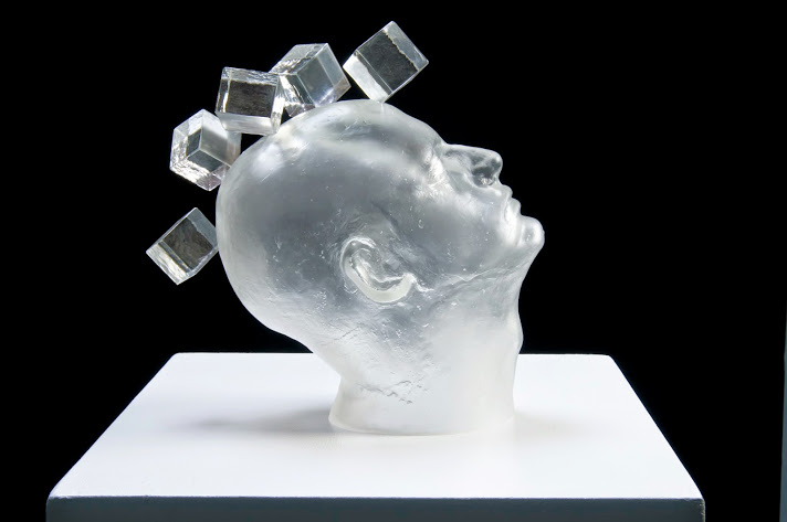 """Tom Ryder's Reflections """"Man Made Beauty,"""" made with blown and hot sculpted glass, is part of"""