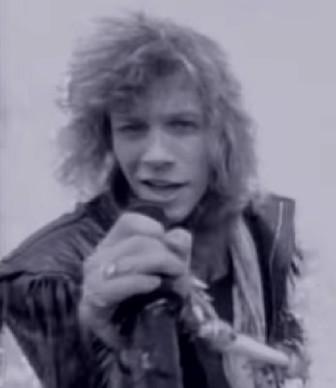 "Jon Bon Jovi in the ""Livin' on a Prayer"" video."