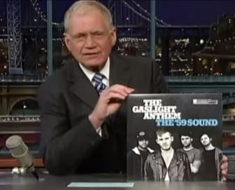 "David Letterman holds up The Gaslight Anthem's album, ""The '59 Sound."""