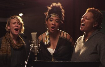"Fischer, right, with Jo Lawry, left, and Judith Hill, in ""20 Feet From Stardom."""
