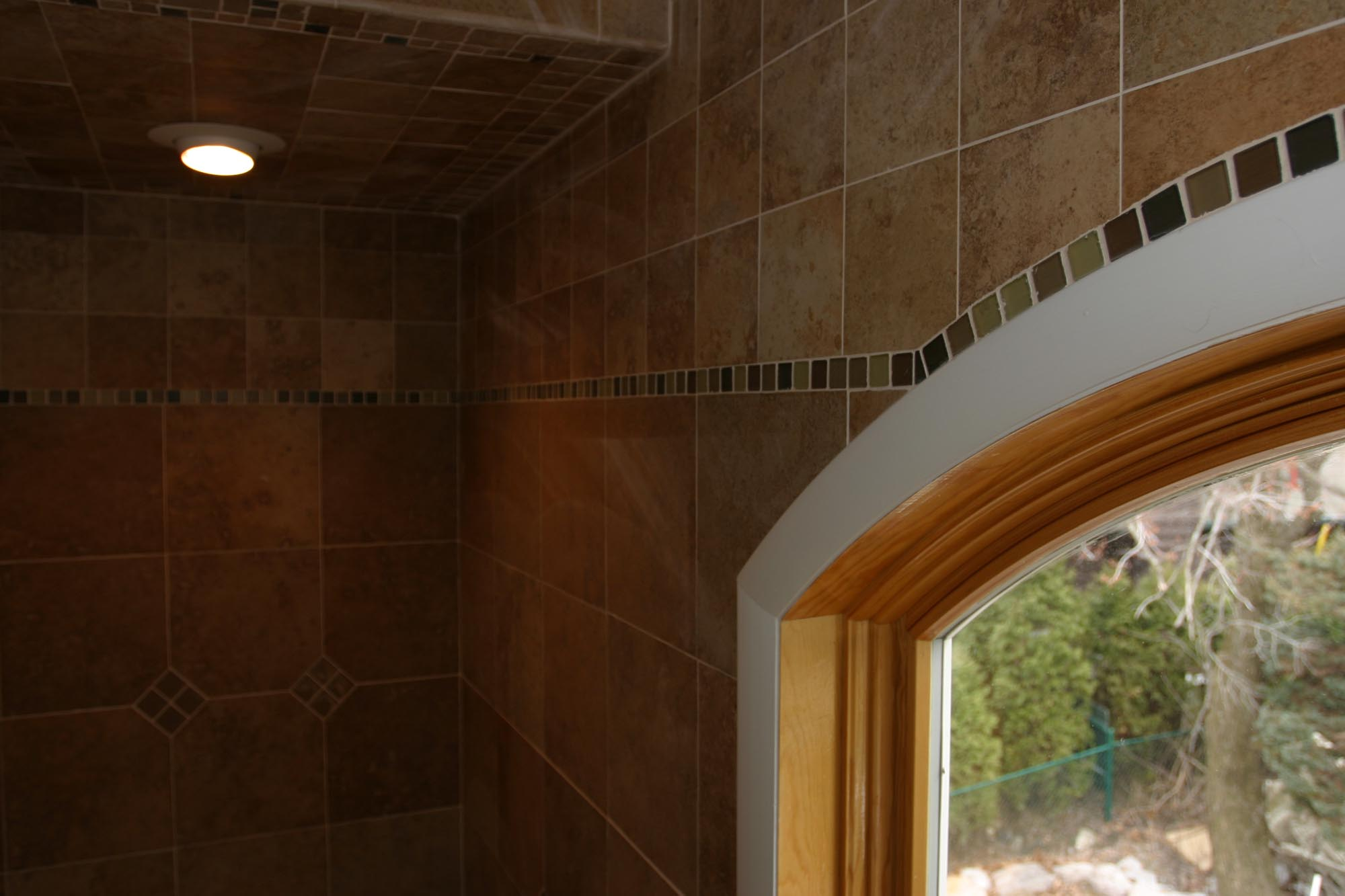Bathroom wall and ceiling tile with custom glass border