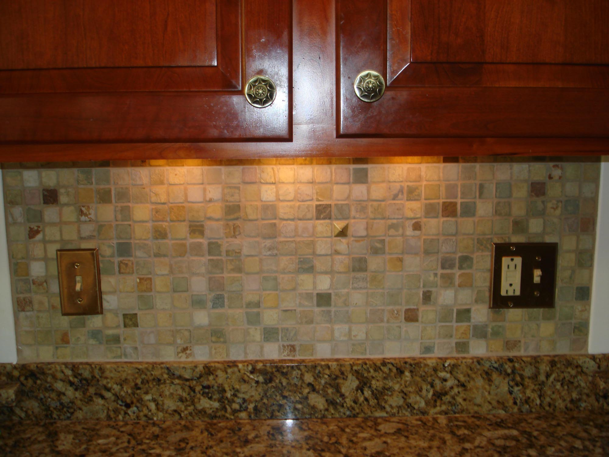 Stone mossaic backsplash with metal decos  New Jersey