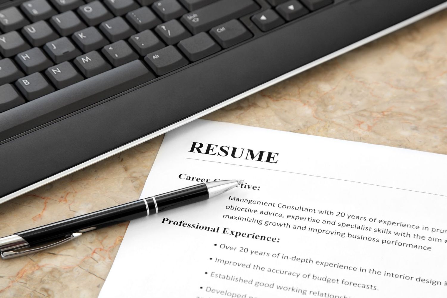 14255959 – resume with pen and keyboard on the table