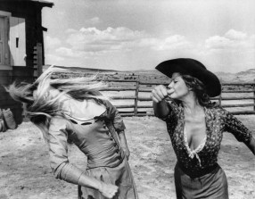 Unknown set photographer. Advertising still to promote the French (filmed in Spain) spaghetti western 'Les Pétroleuses' (directed by Christian-Jaque) with Brigitte Bardot (left) and Claudia Cardinale (right) 1971.