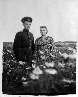 Anonymous photographer and couple. Soviet Union, mid 20th century.