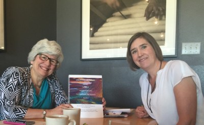 Outreach Chair Laura Walth (left) shares the Poetry in the Schools project with Theresa Jackson, 4th grade teacher at Moore Elementary (an International Baccalaureate School) in Des Moines, Iowa.