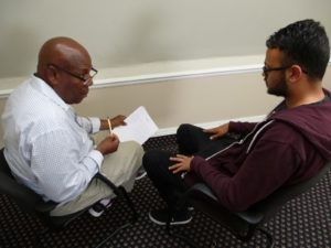 Practitioner and patient sitting to compare CBT with NLP