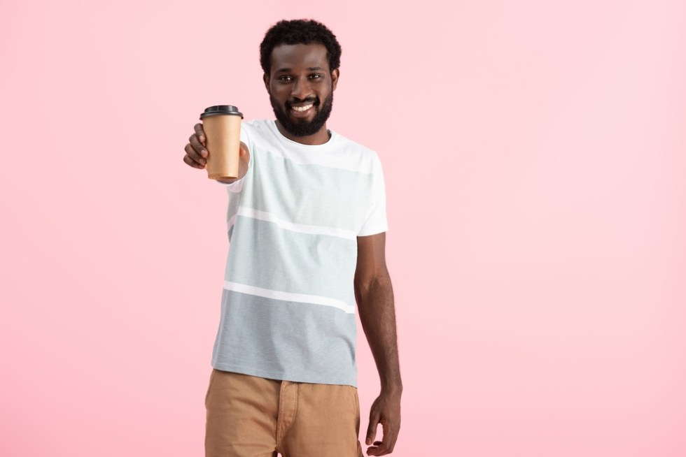 Smiling black man with coffee