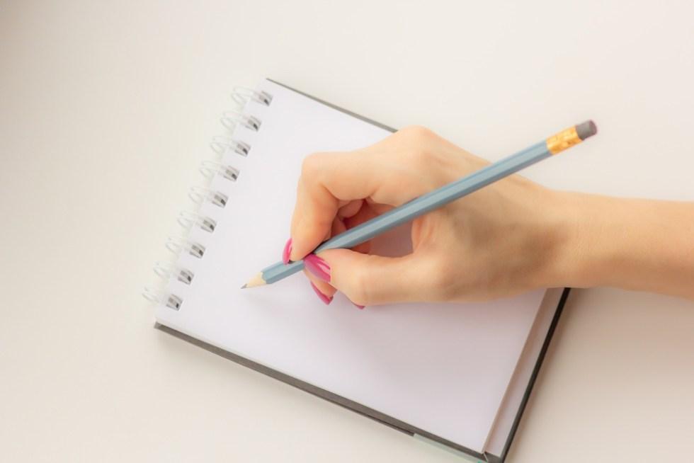 Women's hand writing in journal