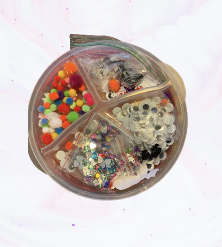 Container filled with collage materials for kids arts and crafts