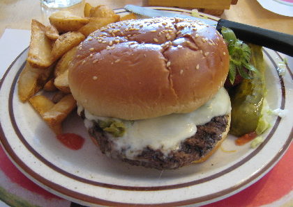 Green chile cheeseburger with home fries