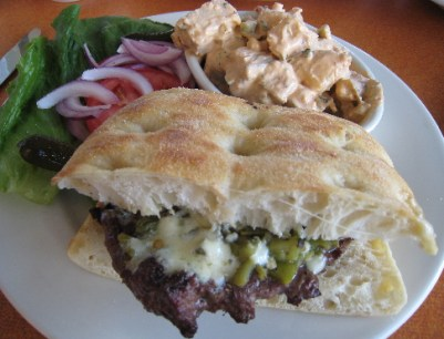 The quintessential burger with green chile and gorgonzola