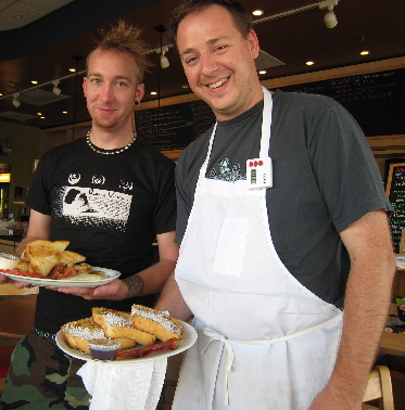 Sean Padgett (left) and Jud Lewis-Mahon deliver breakfast to a lucky table.